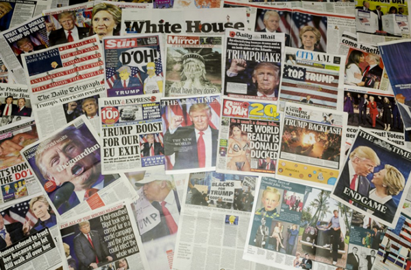 Amercian and UK daily newspapers with big headlines about us election